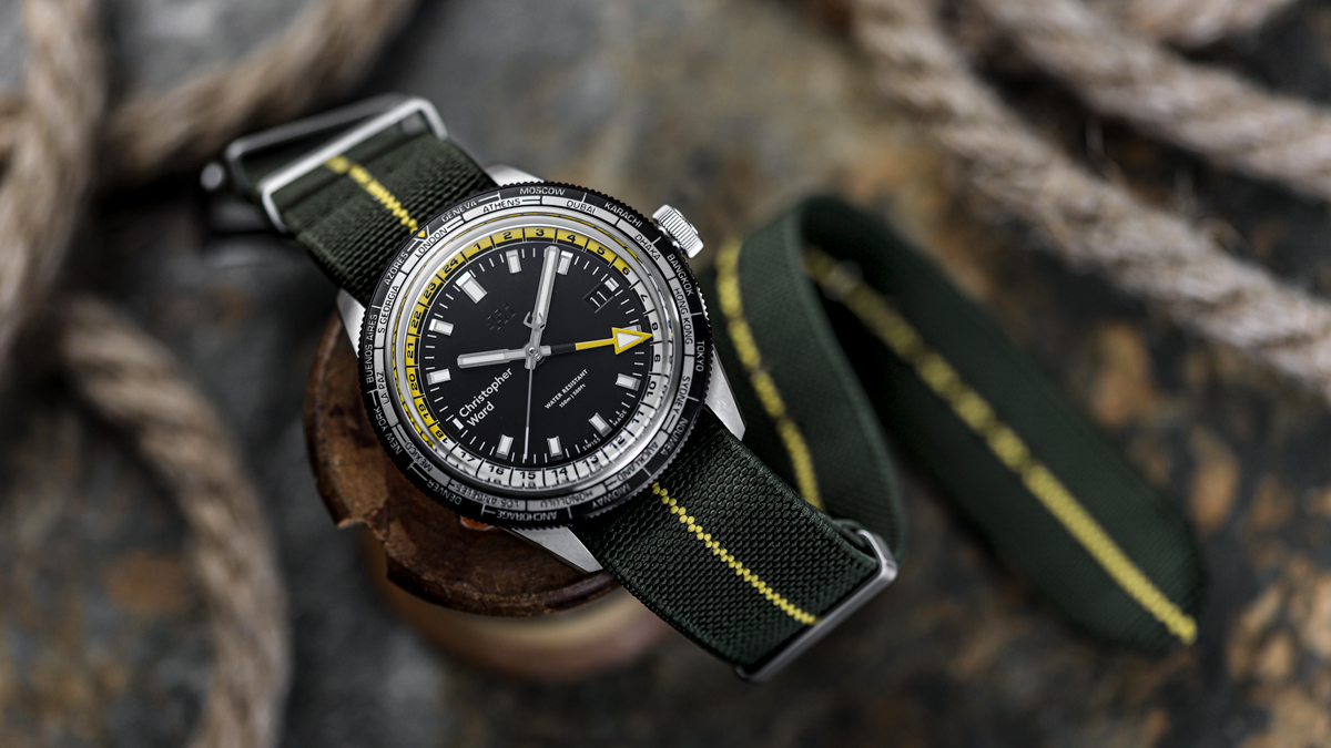 The Christopher Ward C65 Trident GMT Worldtimer watch on an elastic green and yellow E-NATO by ZULUDIVER