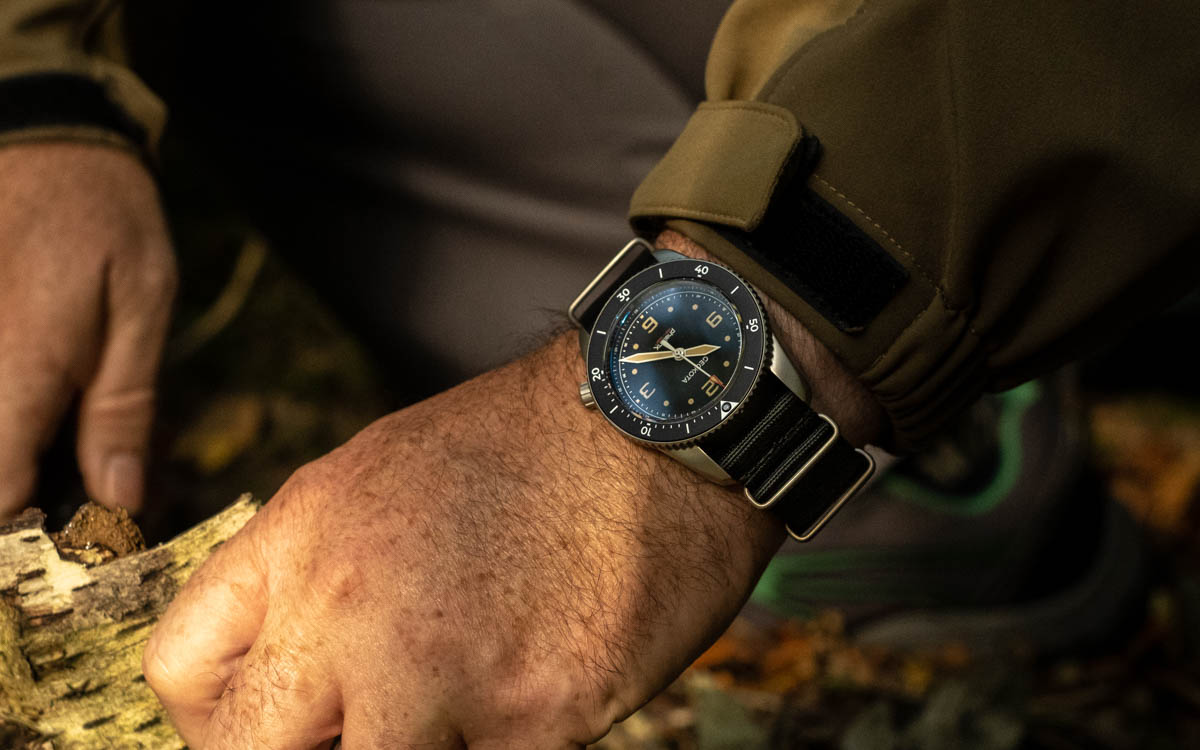 The Geckota S-01 Phalanx watch on the wrist in the outdoors