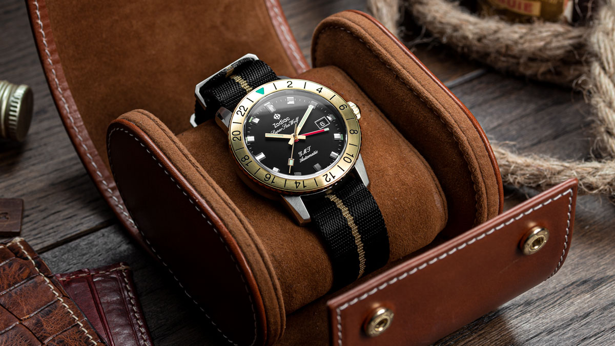 The Zodiac Super Sea Wolf GMT on a black and gold nylon nato watch strap from watchgecko