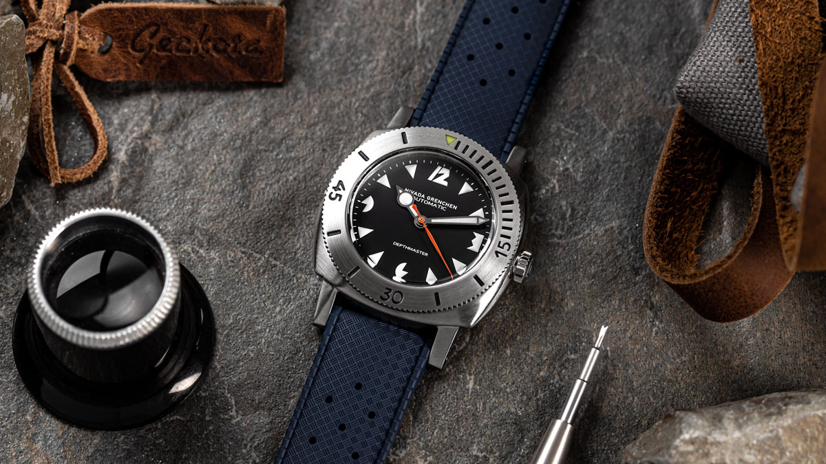 The Nivada Grenchen Pacman on a blue tropic rubber watch strap