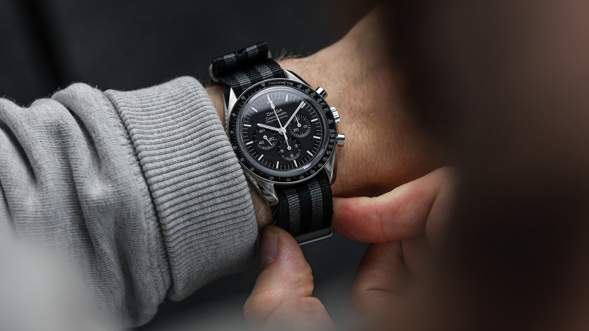 The Omega Speedmaster on a grey and black striped nylon NATO strap by ZULUDIVER