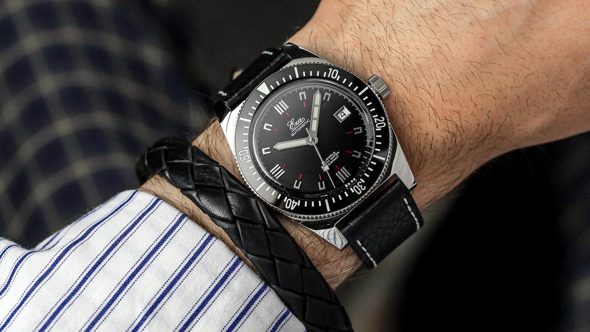 The Black Eza 1972 Dive Watch fitted to a black leather strap on the wrist
