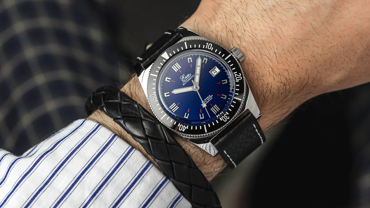 The black Eza 1972 Dive Watch fitted to a black leather strap