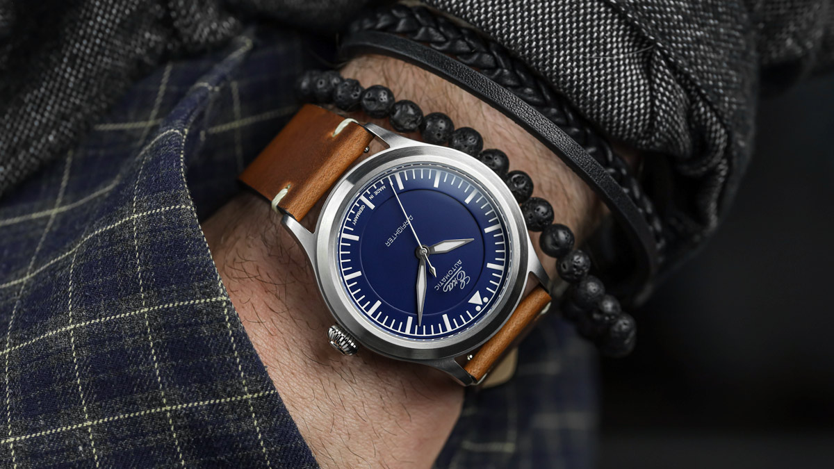 The Blue Eza AirFighter Pilots Watch fitted to a brown leather strap on the wrist
